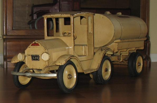 Sturditoy u s army truck, sturditoy orange coal truck,  Sturditoy trucks price guide, sturditoy trucks value guide, sturditoy truck values, sturditoy truck on ebay, sturditoy truck for sale, buying vintage sturditoy trucks contact sturditoy museum, sturditoy oil tanker with lights, ebay, beige white sturditoy ambulance, grey sturditoy huckster, blue sturditoy  construction truck, sturditoy wrecker truck with headlights, navy blue sturditoy police truck, antique toy appraisals, buying all sturditoy trucks any condition, navy blue sturditoy u s mail truck needed, sturditoy trucks, sturditoy oil truck, sturditoy u s army trucks, buddy l truck museum, buying sturditoy trucks, sturditoy police truck, sturditoy armored truck,,sturditoy side dump truck,,sturditoy ebay auctions for sale, sturditoy dump truck,sturditoy police department truck,sturditoy fire truck,sturditoy coal truck,,buddy l,,vintage sturditoy truck,,sturditoy prices, antique sturditoy dump truck,  antique,,buddy l trucks,,sturditoy wrecker, sturditoy price guide with offical sturditoy appraisals Sturditoy coal truck with sturditoy coal chute displayed within the buddy l sturditoy truck museum, sturditoy oil truck for sale